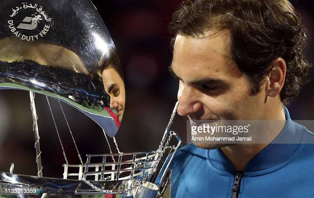 Roger Federer of Switzerland poses with his trophy after defeating Stefanos Tsitsipas of Greece in their final match day Fourteen of the Dubai Duty...