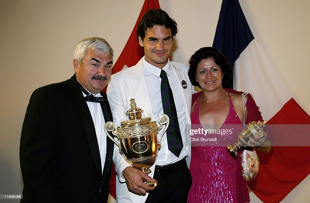 Roger Federer of Switzerland poses with his trophy and parents Lynettee and Robert at the Wimbledon Winners' Dinner at the Savoy Hotel on July 9, 2006 in London, England.