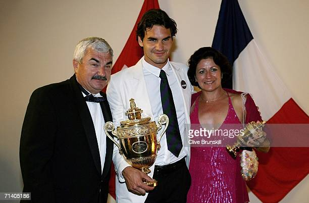 Roger Federer of Switzerland poses with his trophy and parents Lynettee and Robert at the Wimbledon Winners' Dinner at the Savoy Hotel on July 9 2006...