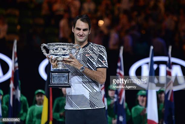 Roger Federer of Switzerland poses with the championship trophy after Australian Open 2017 men's final match against Rafael Nadal of Spain at Rod...