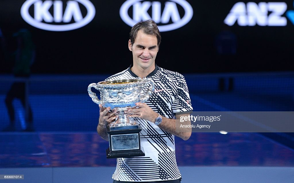 Roger Federer of Switzerland poses with the championship trophy after Australian Open 2017 men's final match against Rafael Nadal of Spain at Rod Laver Arena, in Melbourne, Australia 29 January 2017.