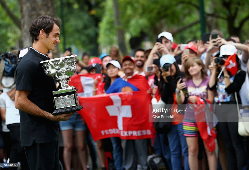 Roger Federer of Switzerland poses with the Norman Brookes Challenge Cup in front his fans and the worlds media after winning the 2017 Australian Open Men's Singles Final, on January 30, 2017 in Melbourne, Australia.