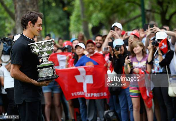 Roger Federer of Switzerland poses with the Norman Brookes Challenge Cup in front his fans and the worlds media after winning the 2017 Australian...