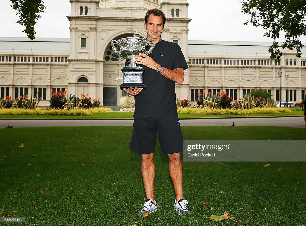Roger Federer of Switzerland poses with the Norman Brookes Challenge Cup after winning the 2017 Australian Open Men's Singles Final, on January 30, 2017 in Melbourne, Australia.