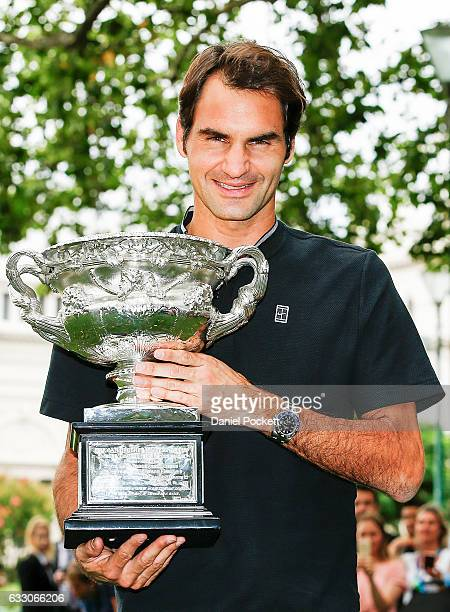 Roger Federer of Switzerland poses with the Norman Brookes Challenge Cup after winning the 2017 Australian Open Men's Singles Final, on January 30,...
