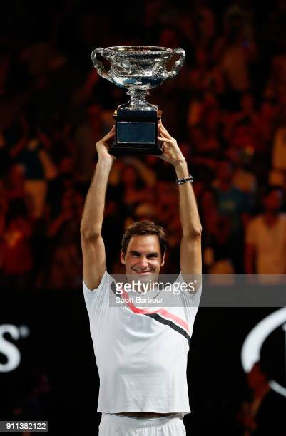 Roger Federer of Switzerland poses with the Norman Brookes Challenge Cup after winning the 2018 Australian Open Men's Singles Final against Marin...