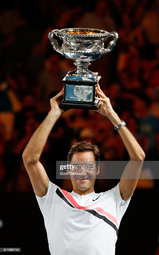 Roger Federer of Switzerland poses with the Norman Brookes Challenge Cup after winning the 2018 Australian Open Men's Singles Final against Marin Cilic of Croatia on day 14 of the 2018 Australian Open at Melbourne Park on January 28, 2018 in Melbourne, Australia.