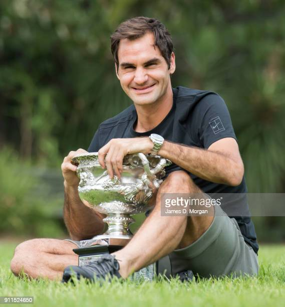 Roger Federer of Switzerland poses with the Norman Brookes Challenge Cup after winning the 2018 Australian Open Men's Singles Final at Government...
