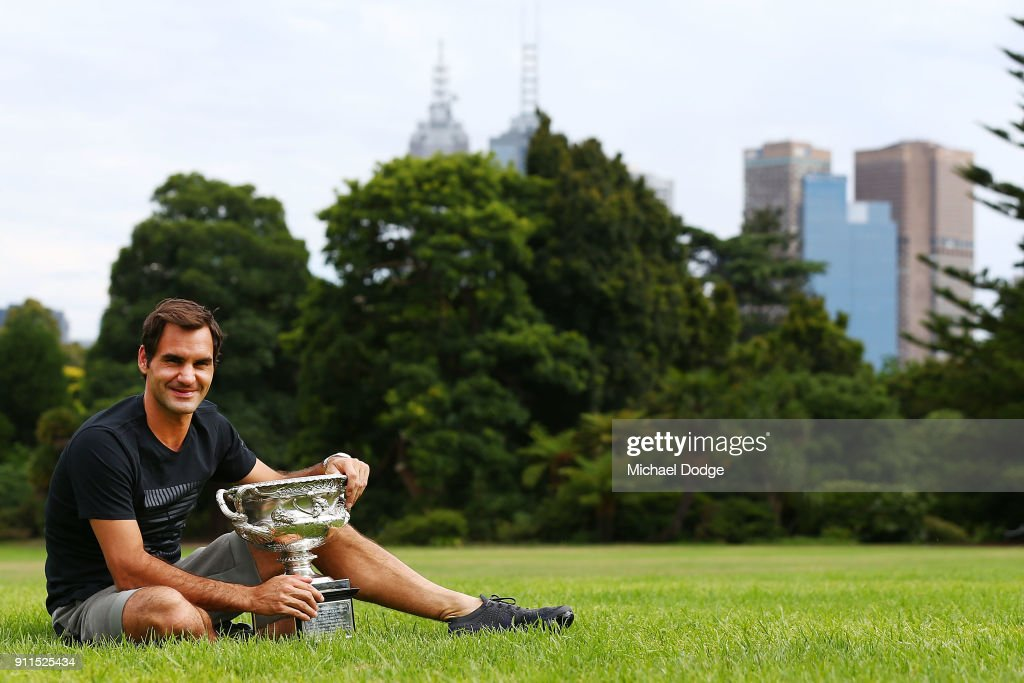 Roger Federer of Switzerland poses with the Norman Brookes Challenge Cup after winning the 2018 Australian Open Men's Singles Final, at Government House on January 29, 2018 in Melbourne, Australia.