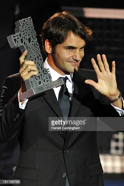 Roger Federer of Switzerland poses with the Number 1 HistoryAward during day two of the Swiss Indoors at St Jakobshalle on November 1 2011 in Basel...