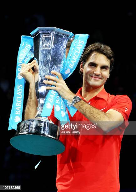 Roger Federer of Switzerland poses with the trophy after defeating Rafael Nadal of Spain in their men's final match during the ATP World Tour Finals...