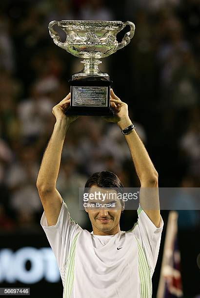 Roger Federer of Switzerland poses with the trophy after victory in his Men's Singles Final match against Marcos Baghdatis of Cyprus during day...