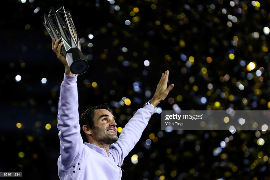 Roger Federer of Switzerland poses with the trophy during the award ceremony after winning his Men's singles final match against Rafael Nadal of Spain on day 8 of 2017 ATP Shanghai Rolex Masters at Qizhong Stadium on October 15, 2017 in Shanghai, China.