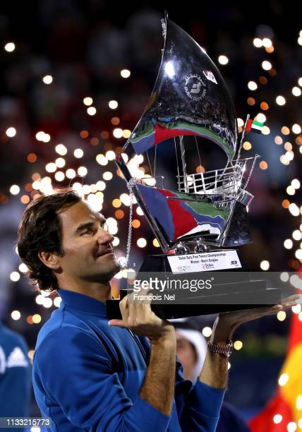 Roger Federer of Switzerland poses with the winners trophy after victory during day fourteen of the Dubai Duty Free Championships at Tennis Stadium...