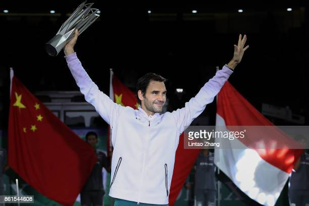 Roger Federer of Switzerland poses with the winner's trophy after defeating Rafael Nadal of Spain duirng the Men's singles final mach on day eight of...