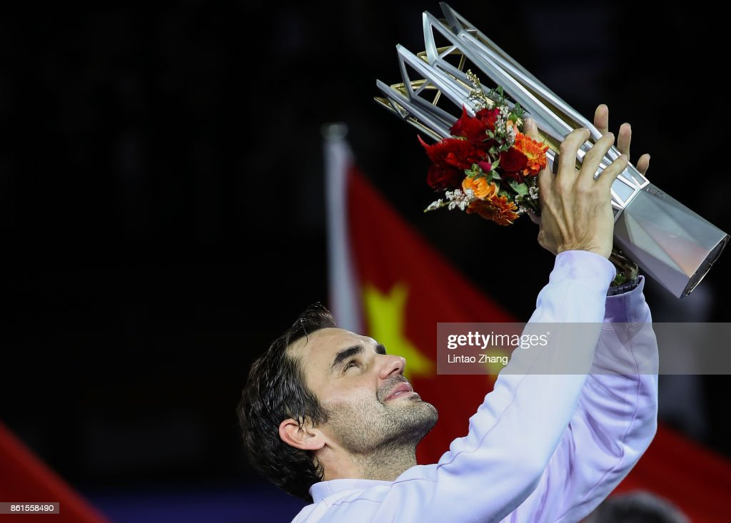 Roger Federer of Switzerland poses with the winner's trophy after defeating Rafael Nadal of Spain during the Men's singles final match on day eight of 2017 ATP Shanghai Rolex Masters at Qizhong Stadium on October 15, 2017 in Shanghai, China.