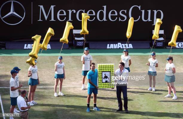 Roger Federer of Switzerland poses with tournament director Edwin Weindorfer and ball kids after defeating Nick Kyrgios of Australia and returning to...