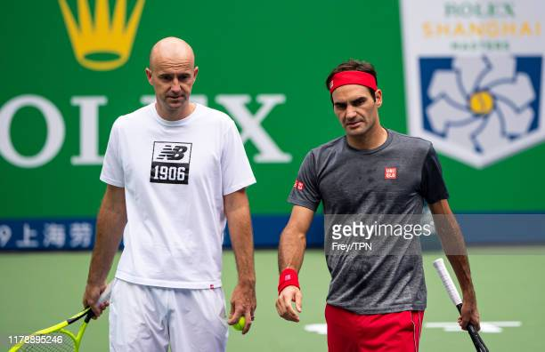 Roger Federer of Switzerland practices with his coach, Ivan Ljubicic at Qi Zhong Tennis Centre on October 04, 2019 before the start of the Rolex...