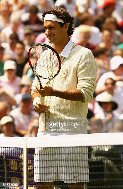 Roger Federer of Switzerland prapares for his men's singles round one match against Dominik Hrbaty of Slovakia on day one of the Wimbledon Lawn...