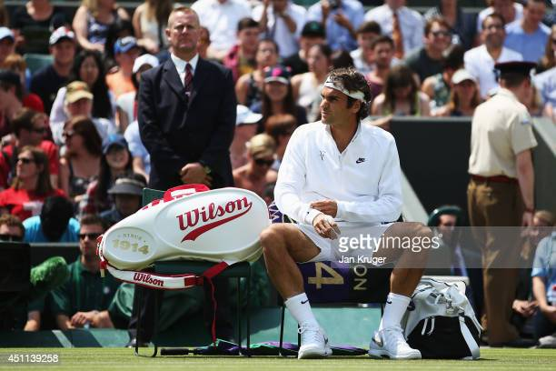 Roger Federer of Switzerland prepares for the start of his Gentlemen's Singles first round match against Paolo Lorenzi of Italy on day two of the...