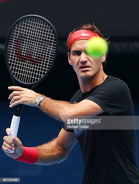 Roger Federer of Switzerland prepares to hit a forehand ahead of the 2014 Australian Open at Melbourne Park on January 7 2014 in Melbourne Australia