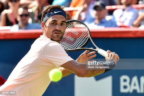 Roger Federer of Switzerland prepares to hit a return against Robin Haase of Netherlands during day nine of the Rogers Cup presented by National Bank...