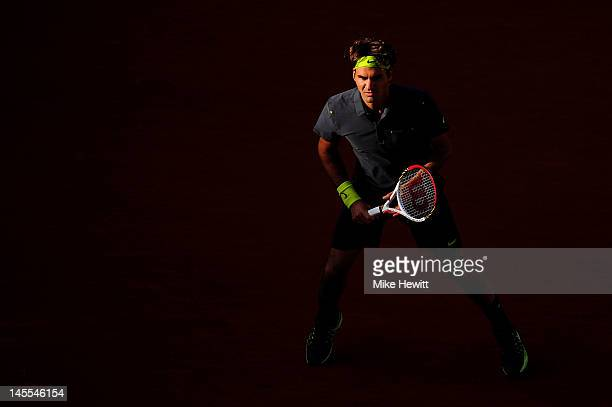 Roger Federer of Switzerland prepares to receive a serve during his men's singles third round match against Nicolas Mahut of France during day six of...