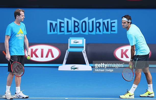 Roger Federer of Switzerland prepares to serve next to coach Stefan Edberg during a practice session ahead of the 2015 Australian Open at Melbourne...