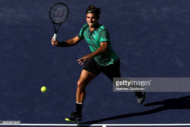 Roger Federer of Switzerland puts away match point against Stan Wawrinka of Switzerland during the men's final of the BNP Paribas Open at the Indian...