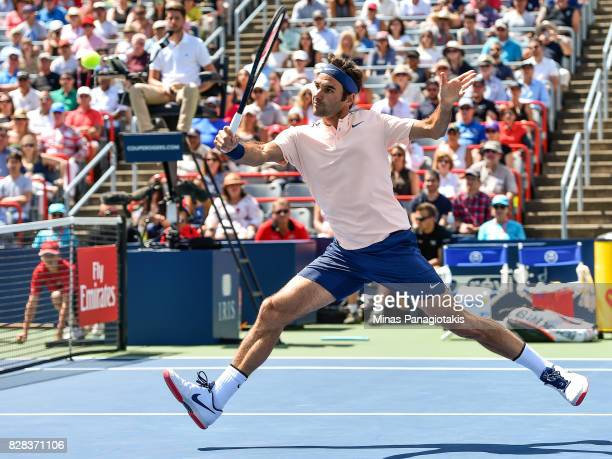 Roger Federer of Switzerland races to the net against Peter Polansky of Canada during day six of the Rogers Cup presented by National Bank at Uniprix...
