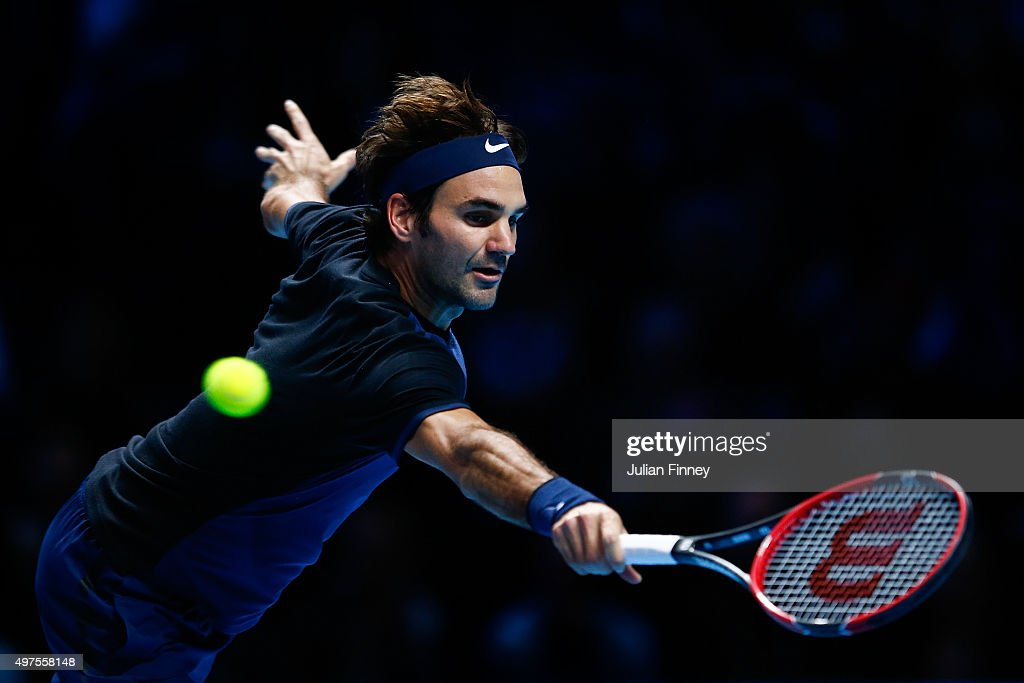 Roger Federer of Switzerland reaches for a backhand in his men's singles match against Novak Djokovic of Serbia during day three of the Barclays ATP World Tour Finals at the O2 Arena on November 17, 2015 in London, England.