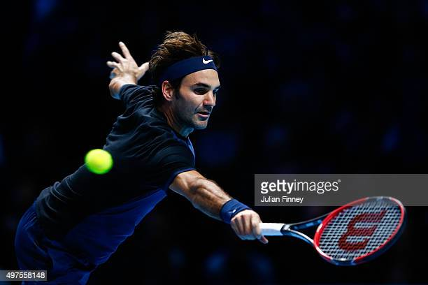 Roger Federer of Switzerland reaches for a backhand in his men's singles match against Novak Djokovic of Serbia during day three of the Barclays ATP...