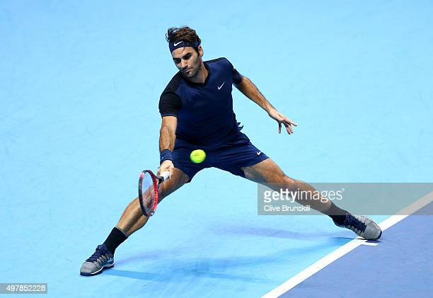 Roger Federer of Switzerland reaches for a forehand in his during his men's singles match against Kei Nishikori of Japan during day five of the...