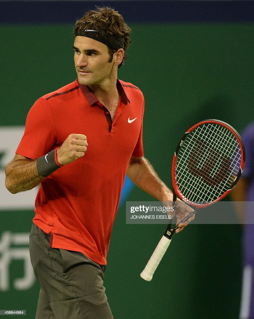 Roger Federer of Switzerland reacts after a point against Leonardo Mayer of Argentina during their men's singles second round match at the Shanghai Masters 1000 tennis tournament held in the Qizhong Tennis Stadium in Shanghai on October 8, 2014.