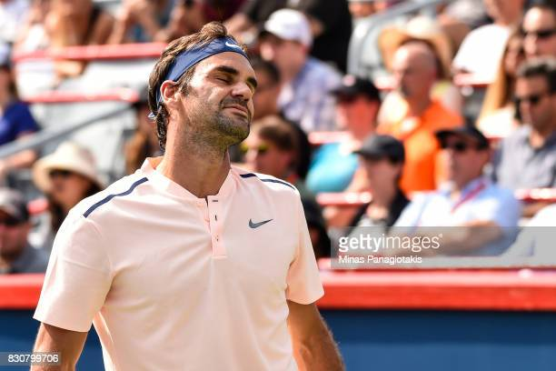 Roger Federer of Switzerland reacts after losing a point against Robin Haase of Netherlands during day nine of the Rogers Cup presented by National...