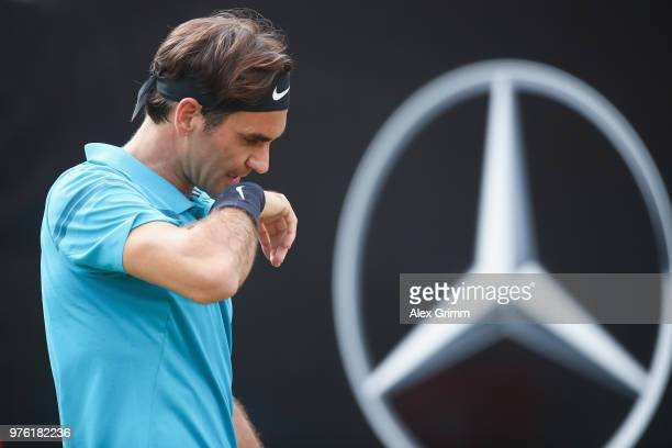 Roger Federer of Switzerland reacts during his match against Nick Kyrgios of Australia during day 6 of the Mercedes Cup at Tennisclub Weissenhof on...