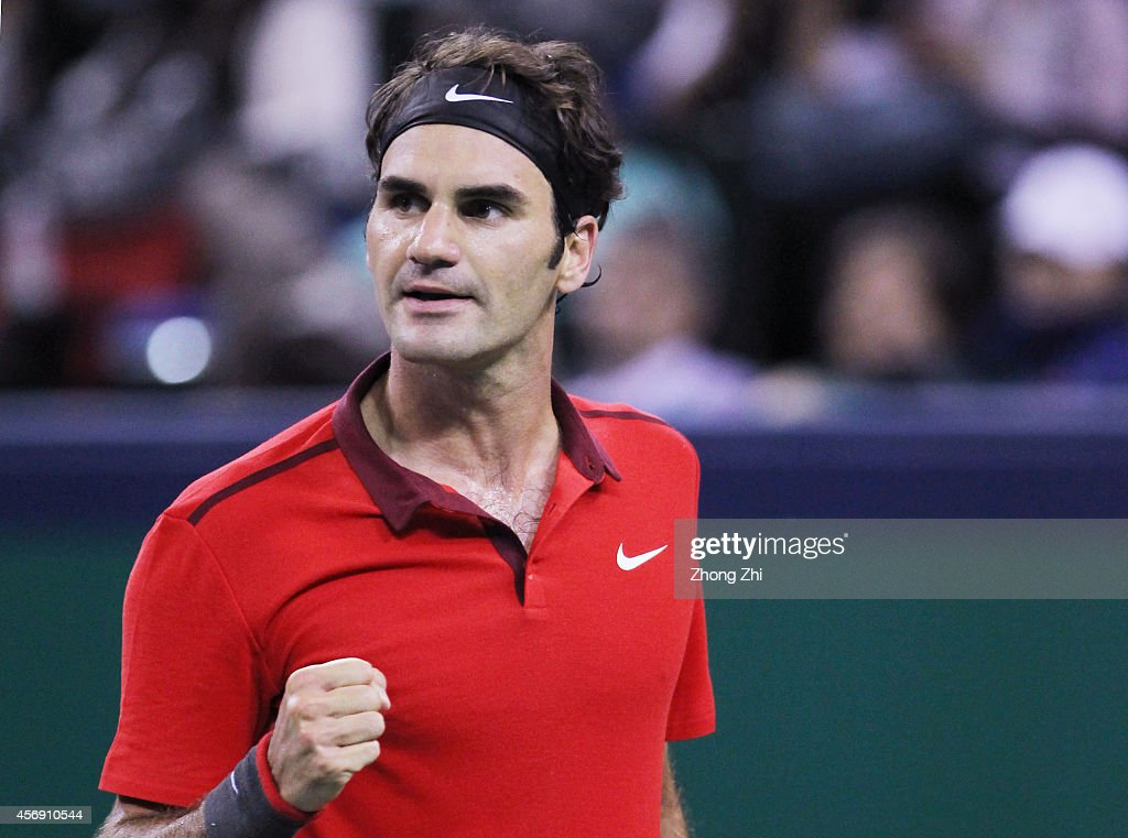 Roger Federer of Switzerland reacts during his match against Roberto Bautista Agut of Spain during the day 5 of the Shanghai Rolex Masters at the Qi Zhong Tennis Center on October 9, 2014 in Shanghai, China.