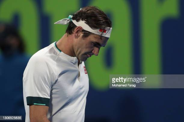 Roger Federer of Switzerland reacts during his quarter final match with Nikoloz Basilashvili of Georgia in the Qatar ExxonMobil Open at Khalifa...