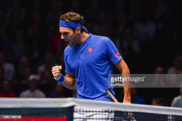Roger Federer of Switzerland reacts during his round robin match against Kevin Anderson of South Africa during Day Five of the Nitto ATP Finals at...