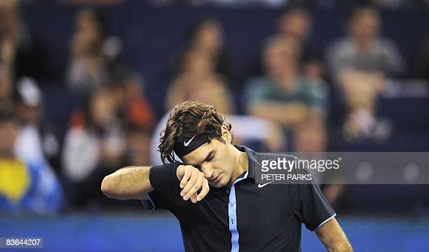 Roger Federer of Switzerland reacts during the final set against Gilles Simon of France in their singles match on the second day of the ATP Masters...
