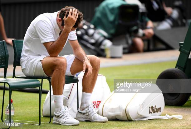 Roger Federer of Switzerland reacts following defeat in his Men's Singles final against Novak Djokovic of Serbia during Day thirteen of The...