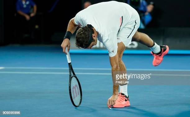 Roger Federer of Switzerland reacts his quarterfinal match against Tomas Berdych of the Czech Republic on day 10 of the 2018 Australian Open at...