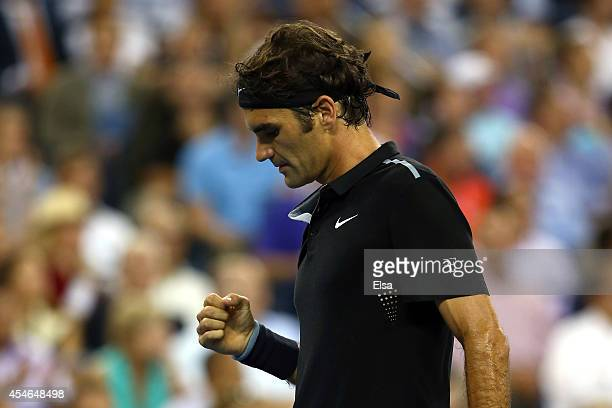 Roger Federer of Switzerland reacts to a point against Gael Monfils of France during their men's singles quarterfinal match on Day Eleven of the 2014...