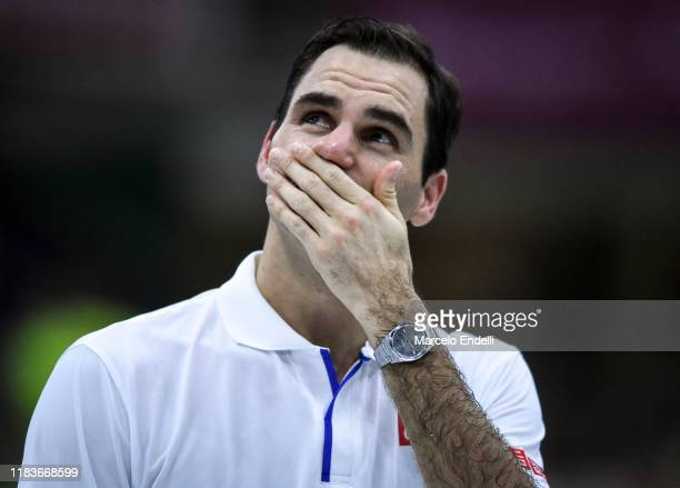Roger Federer of Switzerland reacts with tears as he watches a surprise video from former Argentine football player and coach Diego Maradona talking...
