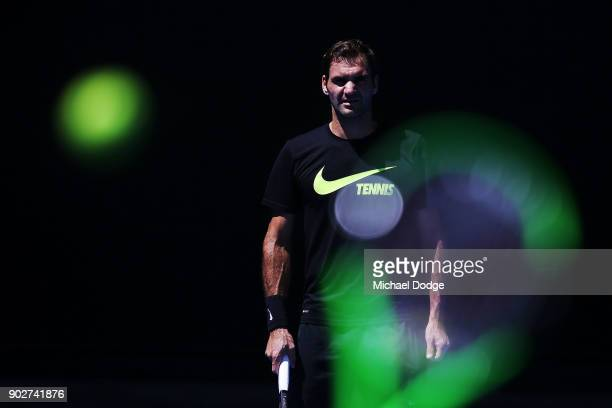 Roger Federer of Switzerland receives serve during a practice session ahead of the 2018 Australian Open at Melbourne Park on January 9 2018 in...