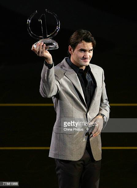 Roger Federer of Switzerland receives the ATP Race 2007 Trophy for finishing the regular season as the numer one player during the Tennis Masters Cup...
