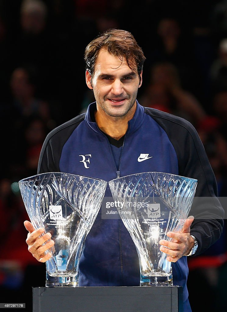 Roger Federer of Switzerland receives the Stefan Edberg Sportsmanship Award and the ATPWorldTour.com Fans' Favourite in Singles presented by Moët & Chandon during day one of the Barclays ATP World Tour Finals at O2 Arena on November 15, 2015 in London, England.