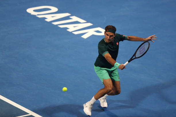 Roger Federer of Switzerland returns a backhand in his match against Dan Evans of Great Britain on Day 3 of the Qatar ExxonMobil Open at Khalifa...