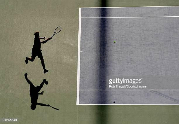Roger Federer of Switzerland returns a ball to Juan Martin Del Potro of Argentina on day fifteen of the 2009 US Open at the USTA Billie Jean King...