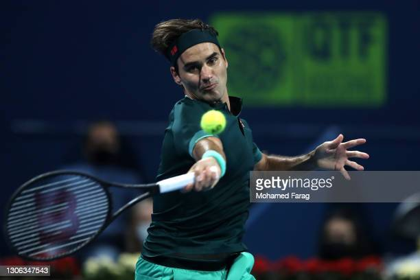 Roger Federer of Switzerland returns a forehand in his match against Dan Evans of Great Britain on Day 3 of the Qatar ExxonMobil Open at Khalifa...